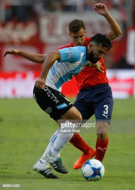 Oscar Carniello of Atletico Rafaela fights for the ball with Nicolas Tagliafico of Independiente during a match between Independiente and Atletico de...