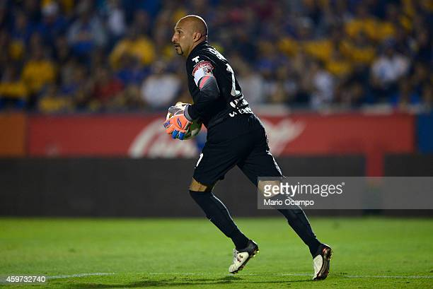 Oscar 'Conejo' Perez goalkeeper of Pachuca handles the ball during a quarterfinal second leg match between Tigres UANL and Pachuca as part of the...