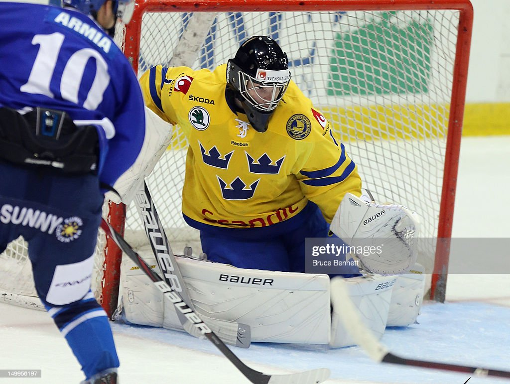<a gi-track='captionPersonalityLinkClicked' href=/galleries/search?phrase=Oscar+Dansk&family=editorial&specificpeople=8613152 ng-click='$event.stopPropagation()'>Oscar Dansk</a> #1 of Team Sweden skates against Team Finland at the USA hockey junior evaluation camp at the Lake Placid Olympic Center on August 7, 2012 in Lake Placid, New York. Team Sweden defeated Finland 8-2.