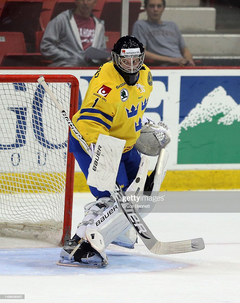 <a gi-track='captionPersonalityLinkClicked' href=/galleries/search?phrase=Oscar+Dansk&family=editorial&specificpeople=8613152 ng-click='$event.stopPropagation()'>Oscar Dansk</a> #1 of Team Sweden skates skates in warmups prior to the game against he USA White Squad at the USA hockey junior evaluation camp at the Lake Placid Olympic Center on August 6, 2012 in Lake Placid, New York. Sweden defeated the USA