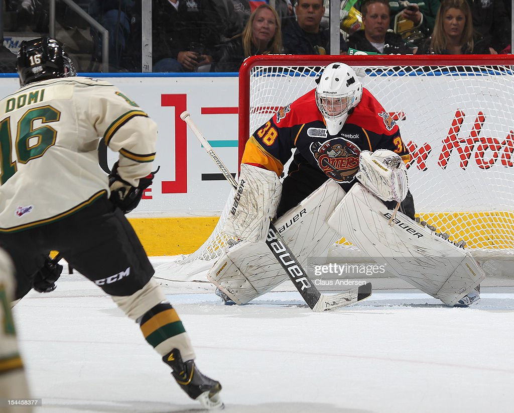 <a gi-track='captionPersonalityLinkClicked' href=/galleries/search?phrase=Oscar+Dansk&family=editorial&specificpeople=8613152 ng-click='$event.stopPropagation()'>Oscar Dansk</a> #38 of the Erie Otters faces Max Domi #16 of the London Knights in an OHL game on October 19, 2012 at the Budweiser Gardens in London, Canada. The Otters defeated the Knights 3-2 in a overtime shoot-out.
