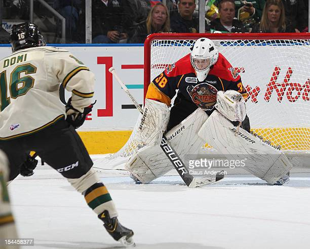 Oscar Dansk of the Erie Otters faces Max Domi of the London Knights in an OHL game on October 19 2012 at the Budweiser Gardens in London Canada The...