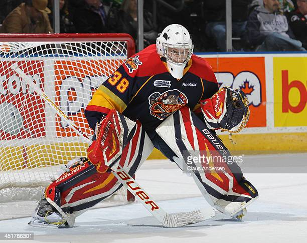 Oscar Dansk of the Erie Otters watches for a shot against the London Knights in an OHL game at the Budweiser Gardens on November 22 2013 in London...