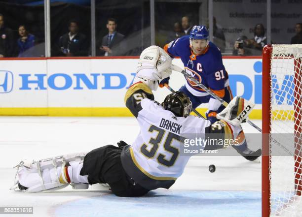 Oscar Dansk of the Vegas Golden Knights blocks the net against John Tavares of the New York Islanders during the second period at the Barclays Center...