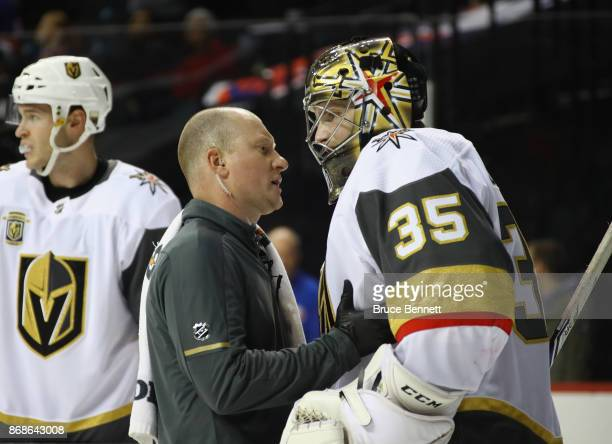 Oscar Dansk of the Vegas Golden Knights is injured during the game against the New York Islanders at the Barclays Center on October 30 2017 in the...