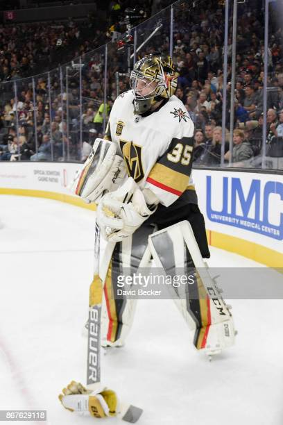 Oscar Dansk of the Vegas Golden Knights picks up a glove during a break in the game against the Colorado Avalanche during the game at TMobile Arena...
