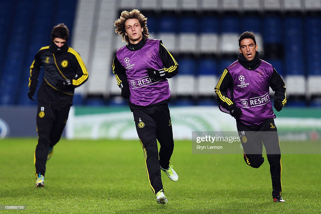 Oscar, <a gi-track='captionPersonalityLinkClicked' href=/galleries/search?phrase=David+Luiz&family=editorial&specificpeople=4133397 ng-click='$event.stopPropagation()'>David Luiz</a> and <a gi-track='captionPersonalityLinkClicked' href=/galleries/search?phrase=Paulo+Ferreira+-+Soccer+Player&family=editorial&specificpeople=185237 ng-click='$event.stopPropagation()'>Paulo Ferreira</a> attend a Chelsea Training Session and Press Conference ahead of tomorrow's UEFA Champion's League match between Chelsea and FC Shakhtar Donetsk at Stamford Bridge on November 6, 2012 in London, England.
