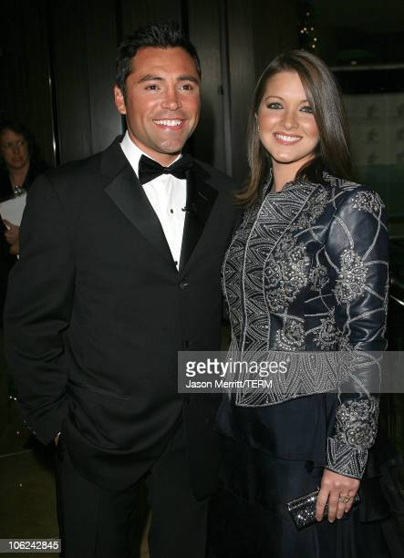 Oscar De La Hoya and wife Millie Corretjer during The 2006 Oscar De La Hoya Foundation 'Evening of Champions' Arrivals at Beverly Hilton Hotel in...