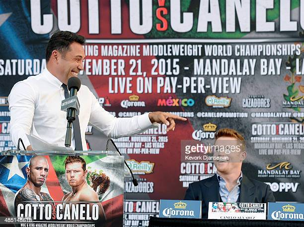 Oscar De La Hoya Chairman and CEO Golden Boy Promotions reacts during a news conference with contender Canelo Alvarez former WBC and WBA Super...