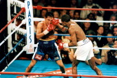 Oscar De La Hoya is hit with a right jab from Felix Trinidad during the fight at the Mandalay Bay Resort Casinoon September 181999 in Las Vegas...
