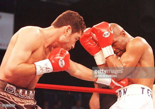 Oscar De La Hoya lands a left to Darryl Tyson's stomach in the second round of their scheduled 12 round fight at Caesars Palace Hotel in Las Vegas De...