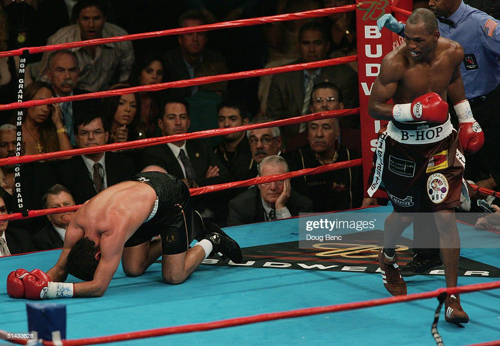 http://media.gettyimages.com/photos/oscar-de-la-hoya-lies-on-the-mat-after-a-knockout-punch-to-the-liver-picture-id51433626