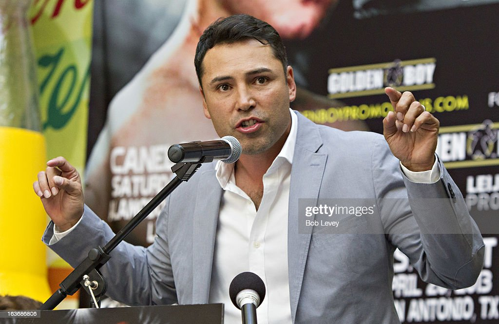 <a gi-track='captionPersonalityLinkClicked' href=/galleries/search?phrase=Oscar+De+La+Hoya&family=editorial&specificpeople=171753 ng-click='$event.stopPropagation()'>Oscar De La Hoya</a> of Golden Boy Promotions speaks to the crowd to promote the upcoming championship fight between Canelo Alvarez and Austin 'No Doubt' Trout to unify the 154-pound super welterweight division durng a press conference on March 14, 2013 in Houston, Texas.