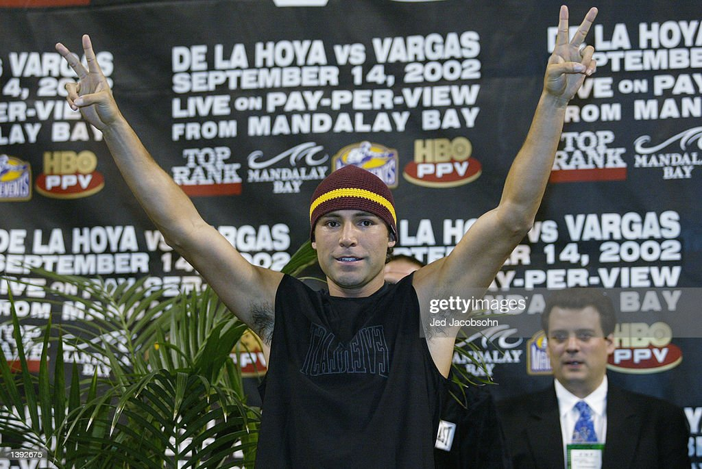 Oscar De La Hoya poses at the weigh-in before his fight against Fernando Vargas on September 14 at the Mandalay Bay Events Center on September 13, 2002 in Las Vegas, Nevada. De La Hoya weighed in at 154 pounds.