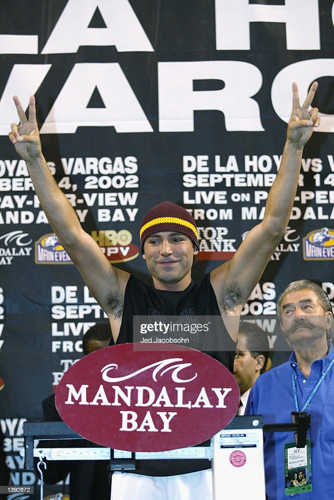 Oscar De La Hoya poses on the scale at the weigh-in before his fight against Fernando Vargas on September 14 at the Mandalay Bay Events Center on September 13, 2002 in Las Vegas, Nevada. De La Hoya weighed in at 154 pounds.