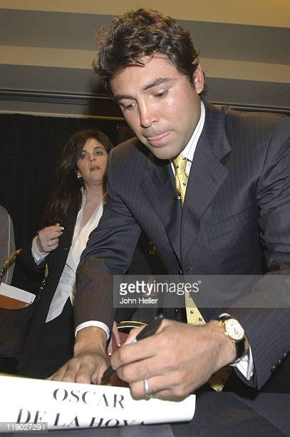 Oscar De La Hoya signs the contract to fight Felix Sturm in June and another contract to fight Bernard Hopkins if he beats Sturm in the fight at the...