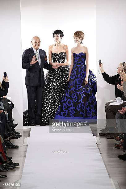 Oscar De La Renta and Karlie Kloss walk the runway at the Oscar De La Renta Ready to Wear Fall/Winter 20142015 fashion show during MercedesBenz...
