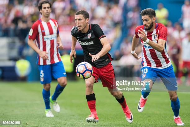 Oscar de Marcos Arana of Athletic Club fights for the ball with Yannick Ferreira Carrasco of Atletico de Madrid during the La Liga match between...