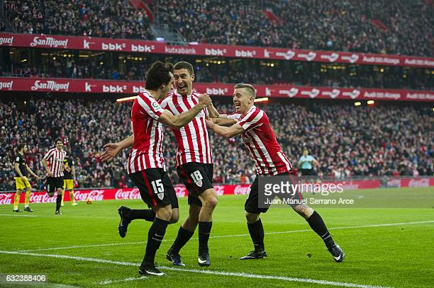 Oscar De Marcos of Athletic Club celebrates with his teammates Iker Muniain and Inigo Lekue of Athletic Club after scoring his team's second goal...