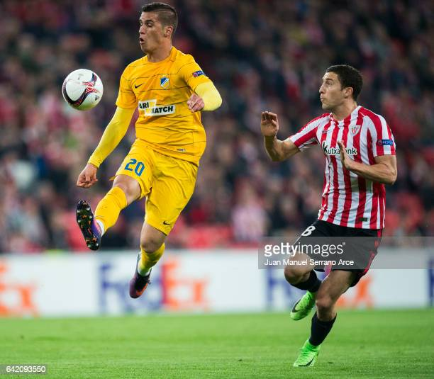 Oscar De Marcos of Athletic Club duels for the ball with Pieros Sotiriou of Apoel Nicosia FC during the UEFA Europa League Round of 32 first leg...