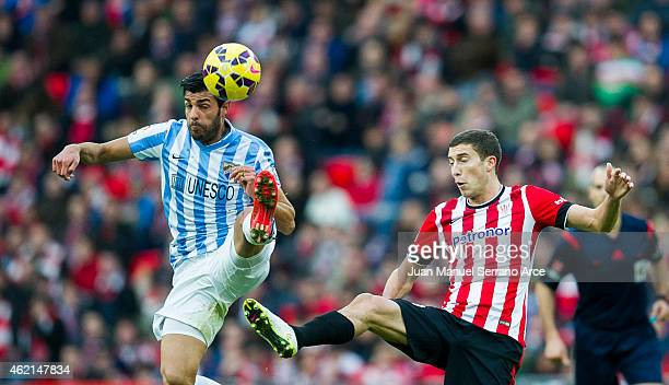 Oscar De Marcos of Athletic Club duels for the ball withÊMiguel Torres of Malaga CF during the La Liga match between Athletic Club and Malaga CF at...