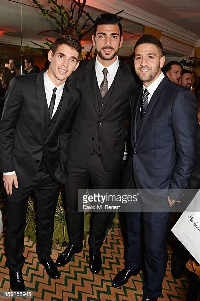 Oscar dos Santos Emboaba Junior Graziano Pelle and Adel Taarabt attend the Claridge's Dolce and Gabbana Christmas Tree party at Claridge's Hotel on...