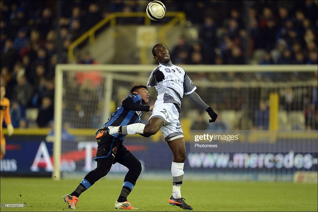 Oscar Duarte of CLub Brugge KV battles for the ball with Derick Ogbu Chuka of OH Leuven during the Jupiler Pro League match between Club Brugge KV and Oud Heverlee Leuven on February 9, 2013 in Brugge, Belgium.