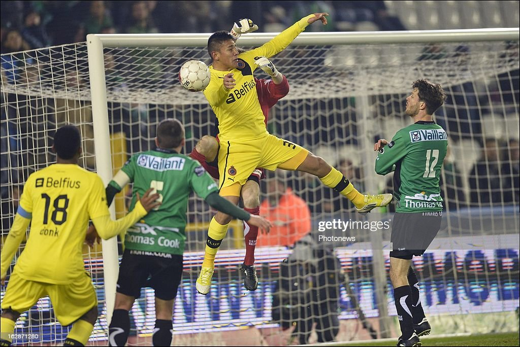 Oscar Duarte of Club Brugge KV competes in the air with goalkeeper Coppens Jo of Cercle Brugge during the Jupiler League match between Cercle Brugge and Club Brugge on February 28, 2013 in Brugge, Belgium.