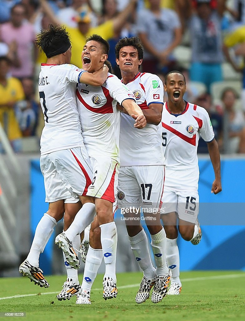 Oscar Duarte of Costa Rica (2nd L) celebrates scoring his team's second goal with teammates <a gi-track='captionPersonalityLinkClicked' href=/galleries/search?phrase=Christian+Bolanos&family=editorial&specificpeople=554945 ng-click='$event.stopPropagation()'>Christian Bolanos</a> (L), <a gi-track='captionPersonalityLinkClicked' href=/galleries/search?phrase=Yeltsin+Tejeda&family=editorial&specificpeople=7624398 ng-click='$event.stopPropagation()'>Yeltsin Tejeda</a> (2nd R) and Junior Diaz (R) during the 2014 FIFA World Cup Brazil Group D match between Uruguay and Costa Rica at Castelao on June 14, 2014 in Fortaleza, Brazil.