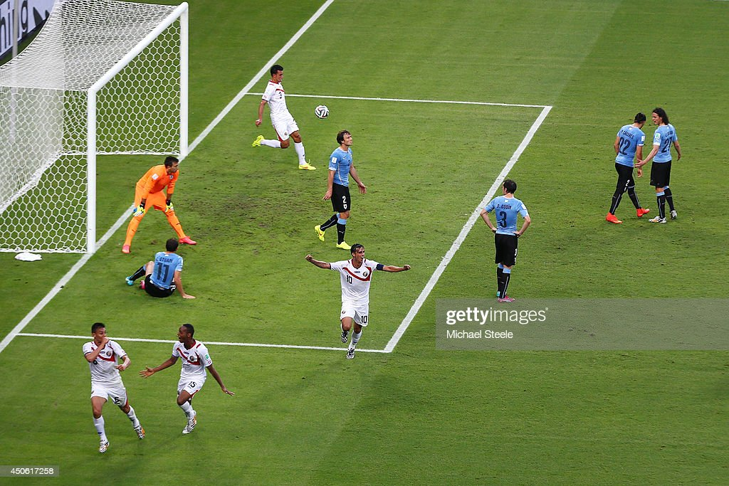 Oscar Duarte of Costa Rica (L) celebrates scoring his team's second goal past <a gi-track='captionPersonalityLinkClicked' href=/galleries/search?phrase=Fernando+Muslera&family=editorial&specificpeople=4283031 ng-click='$event.stopPropagation()'>Fernando Muslera</a> of Uruguay with teammates Junior Diaz (2nd L) and <a gi-track='captionPersonalityLinkClicked' href=/galleries/search?phrase=Bryan+Ruiz&family=editorial&specificpeople=714489 ng-click='$event.stopPropagation()'>Bryan Ruiz</a> (C) during the 2014 FIFA World Cup Brazil Group D match between Uruguay and Costa Rica at Castelao on June 14, 2014 in Fortaleza, Brazil.