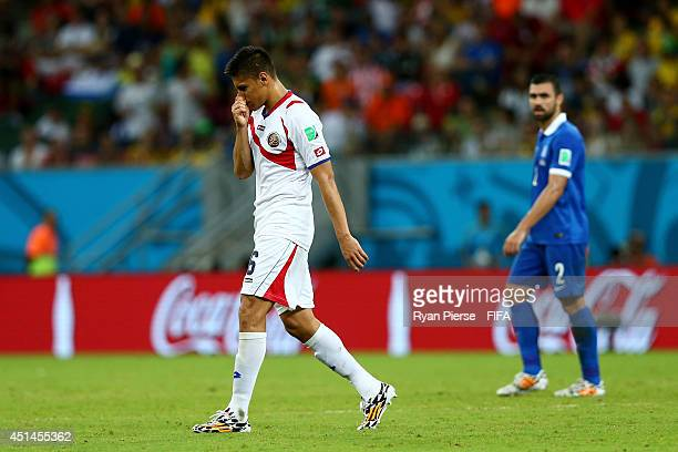 Oscar Duarte of Costa Rica walks off the pitch after being shown a red card off by referee Benjamin Williams during the 2014 FIFA World Cup Brazil...
