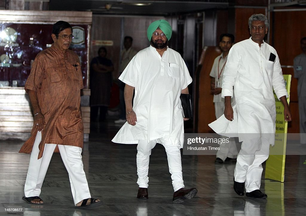 Oscar Fernandes (L), AICC General secretary and Captain <a gi-track='captionPersonalityLinkClicked' href=/galleries/search?phrase=Amarinder+Singh&family=editorial&specificpeople=2907726 ng-click='$event.stopPropagation()'>Amarinder Singh</a> (C) and former Chief Minister of Punjab attend the Congress Working Committee meeting on June 4, 2012 in New Delhi, India. The party's highest decision making body deliberated over worsening economic slowdown and political challenges amidst grave corruption charges and anti-corruption movements by Anna Hazare and Baba Ramdev.