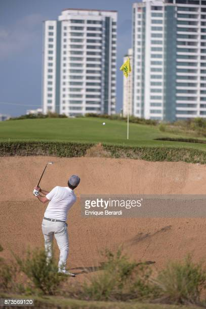 Oscar Fraustro of Mexico hits out of a bunker on the 15th hole during the third round of the PGA TOUR Latinoamerica 64 Aberto do Brasil at the...