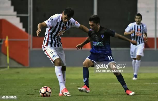 Oscar Gimenez of Paraguay's Libertad vies for the ball with Jair Torrico of Bolivia's Sport Boys during their 2017 Copa Libertadores football match...