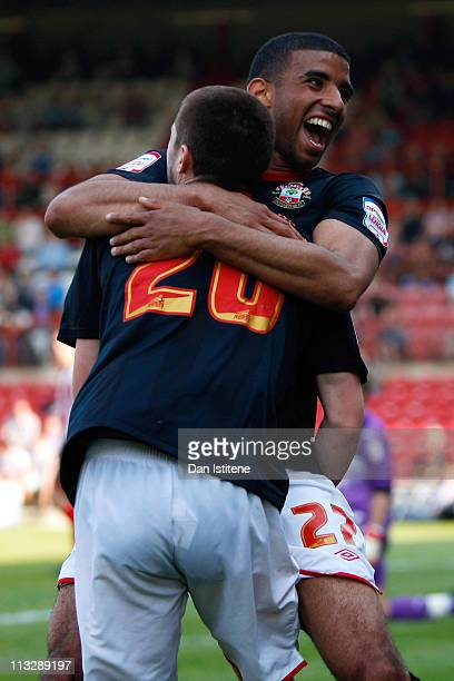 Oscar Gobern of Southampton celebrates with team mate Adam Lallana after scoring his team's third goal during the npower League One match between...