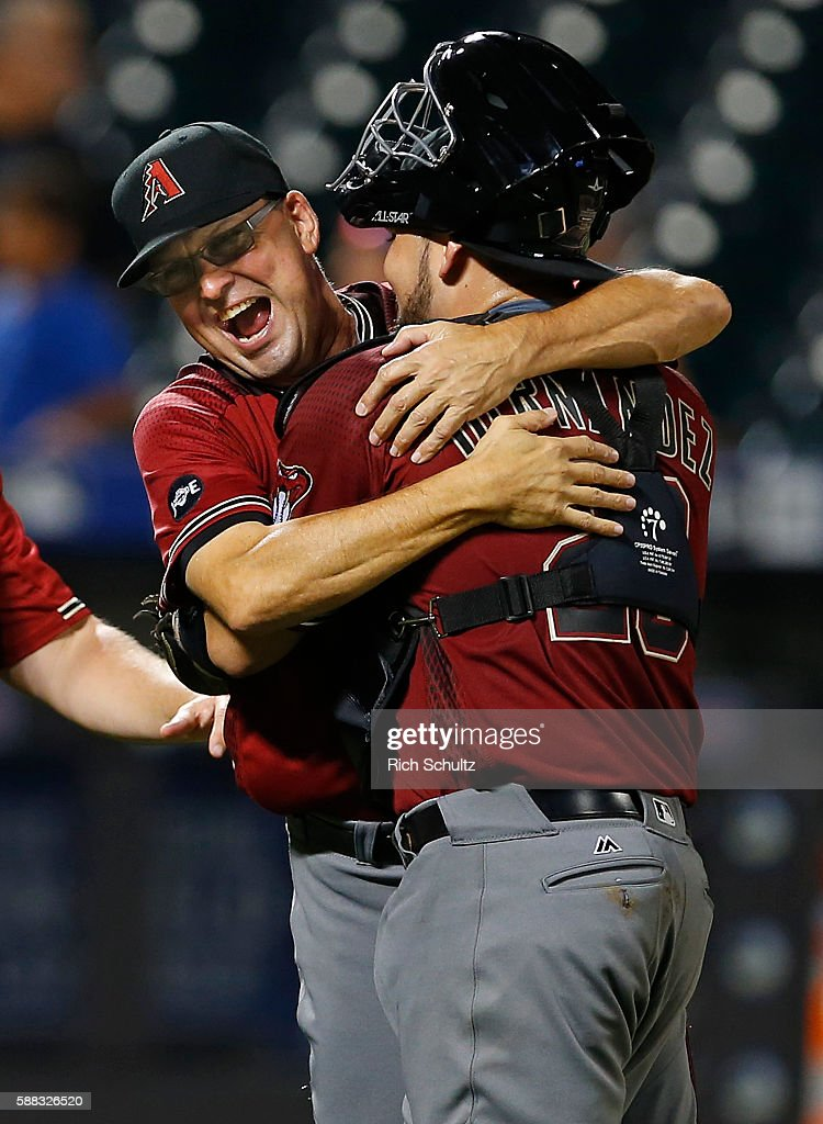Oscar Hernandez #28 of the Arizona Diamondbacks is hugged by assistant hitting coach Mark Grace #17 after the Diamondbacks defeated the New York Mets 3-2 in 12 innings during a game at Citi Field on August 10, 2016 in the Flushing neighborhood of the Queens borough of New York City. The Diamondbacks won 3-2.