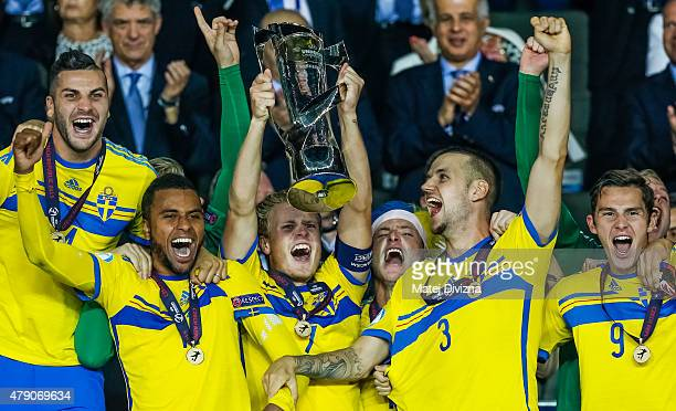 Oscar Hiljemark lifts up trophy with his teammates after Swedish victory in UEFA U21 European Championship final match between Portugal and Sweden at...
