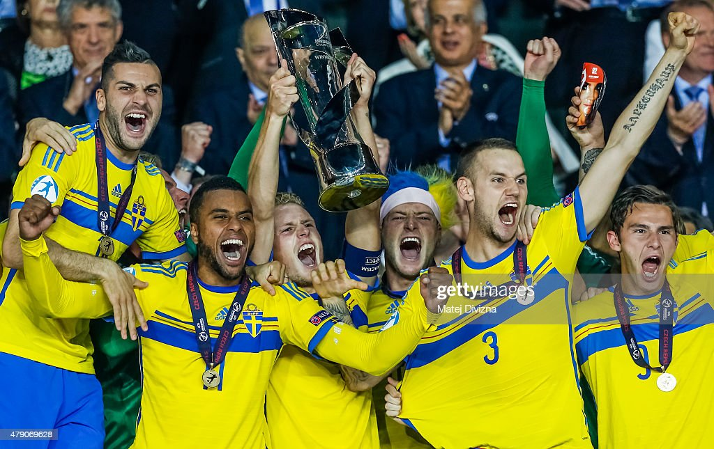 Oscar Hiljemark (3rdL) lifts up trophy with John Guidetti (3rdR) and team-mates after Swedish victory in UEFA U21 European Championship final match between Portugal and Sweden at Eden Stadium on June 30, 2015 in Prague, Czech Republic.