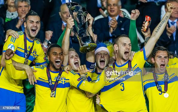 Oscar Hiljemark lifts up trophy with John Guidetti and teammates after Swedish victory in UEFA U21 European Championship final match between Portugal...