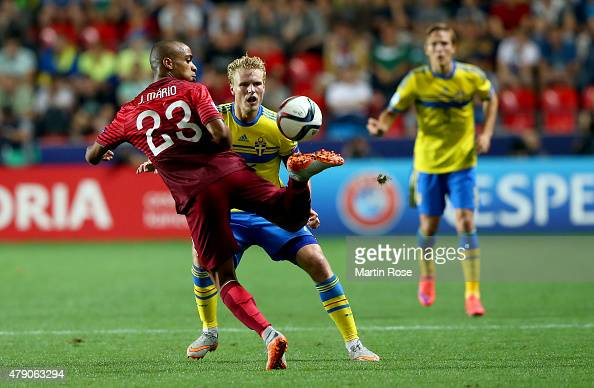 Oscar Hiljemark of Sweden and Joao Mario of Portugal battle for the ball during the UEFA European Under21 final match between Sweden and Portugal at...