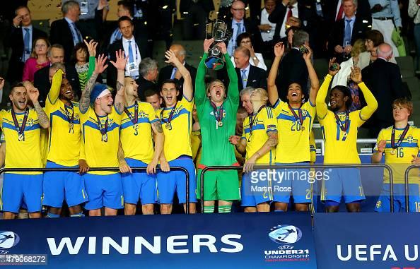 Oscar Hiljemark of Sweden lifts the trophy after winning the UEFA European Under21 final match between Sweden and Portugal at Eden Stadium on June 30...