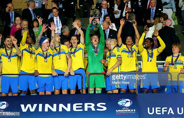 Oscar Hiljemark of Sweden lifts the trophy after winning the UEFA European Under21 final match between Sweden and Portugal at Eden Stadium on June 30...