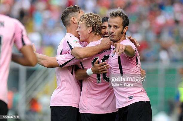 Oscar Hiljemark Oof Palermo celebrates with team mates after scoring his goal during the Serie A match between US Citta di Palermo and Carpi FC at...
