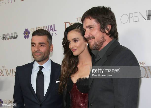 Oscar Isaac Charlotte Le Bon and Christian Bale attend 'The Promise' New York Screening at Paris Theatre on April 18 2017 in New York City