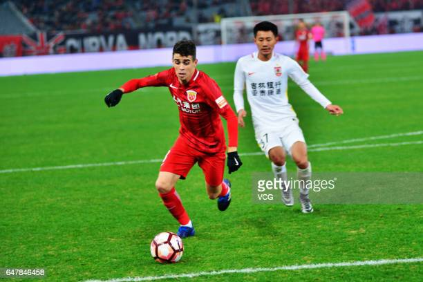 Oscar Junior of Shanghai SIPG dribbles during the Chinese Super League between Shanghai SIPG and Changchun Yatai at Shanghai Stadium on March 4 2017...