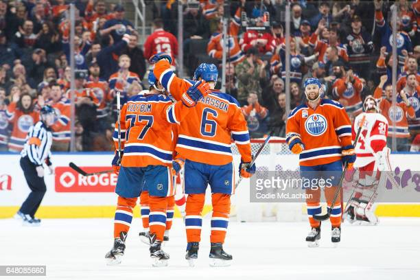 Oscar Klefbom and Adam Larsson of the Edmonton Oilers celebrate Larsson's goal against the Detroit Red Wings on March 4 2017 at Rogers Place in...
