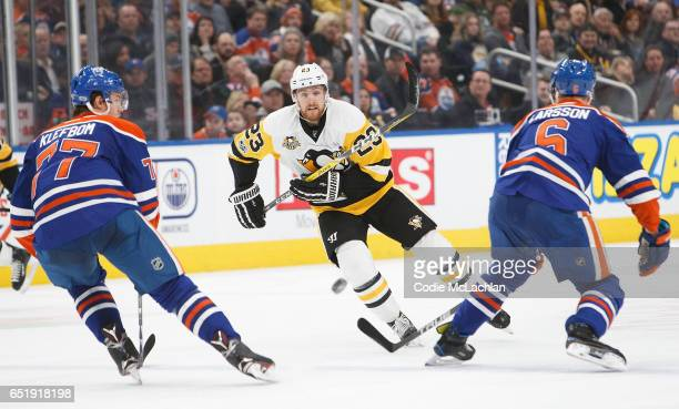 Oscar Klefbom and Adam Larsson of the Edmonton Oilers defend against Scott Wilson of the Pittsburgh Penguins on March 10 2017 at Rogers Place in...