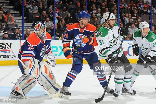 Oscar Klefbom and Richard Bachman of the Edmonton Oilers battle for position against Tyler Seguin of the Dallas Stars during the game on March 27...