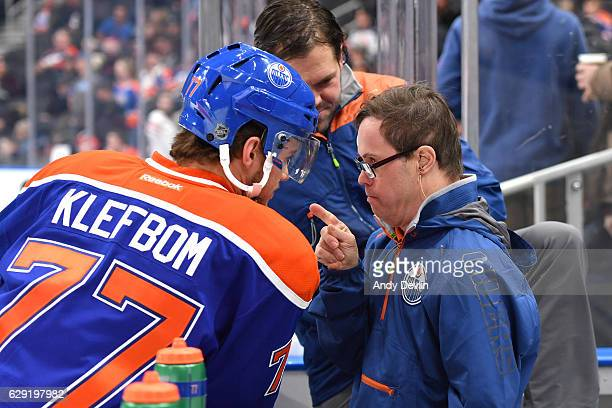 Oscar Klefbom Joey Moss and Stephen Lines of the Edmonton Oilers have a discussion prior to the game against the Winnipeg Jets on December 11 2016 at...