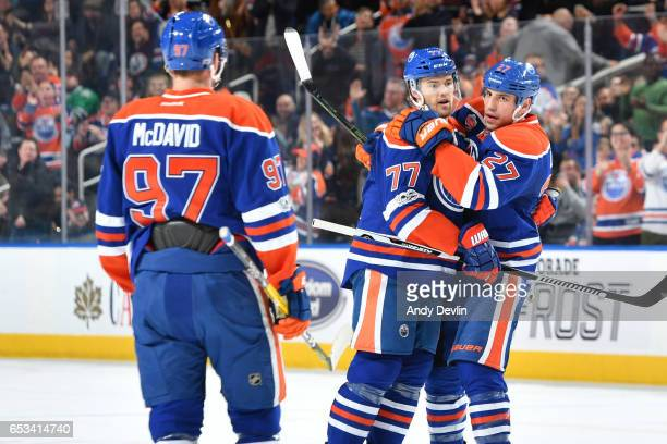 Oscar Klefbom Milan Lucic and Connor McDavid of the Edmonton Oilers celebrate after a goal during the game against the Dallas Stars on March 14 2017...